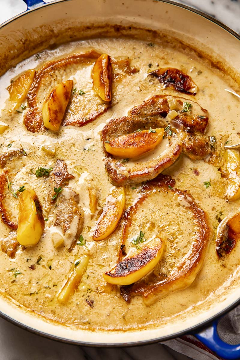Pork chops and apples in creamy apple cider sauce
