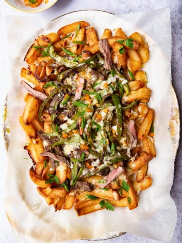 Fries loaded with steak, green peppers and melted cheese.