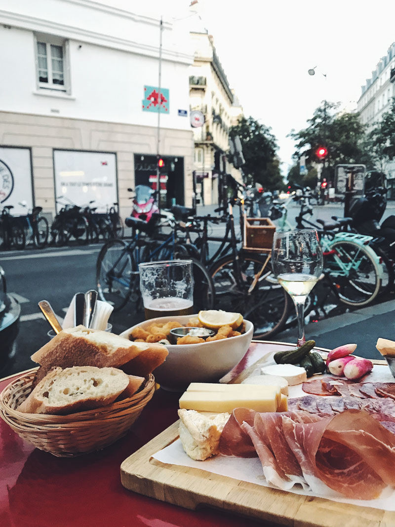 Cafe lunch on a Parisian street, with bicycles in the background