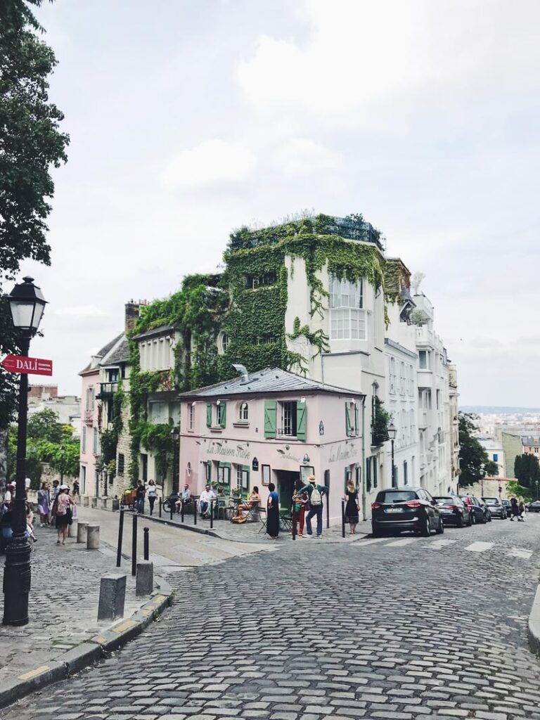 Building in Montmartre covered in ivy, and a cafe