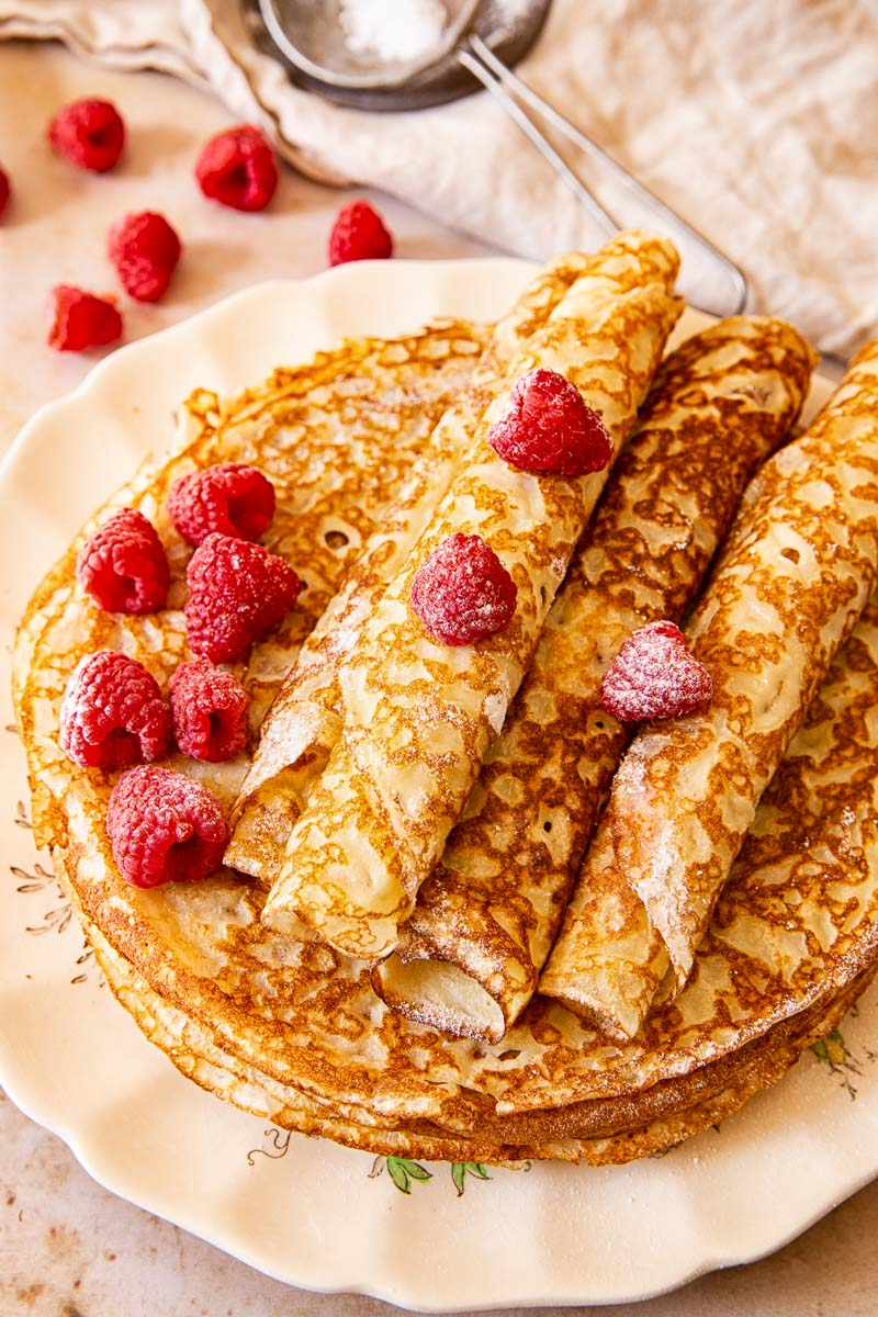 Blini topped with raspberries