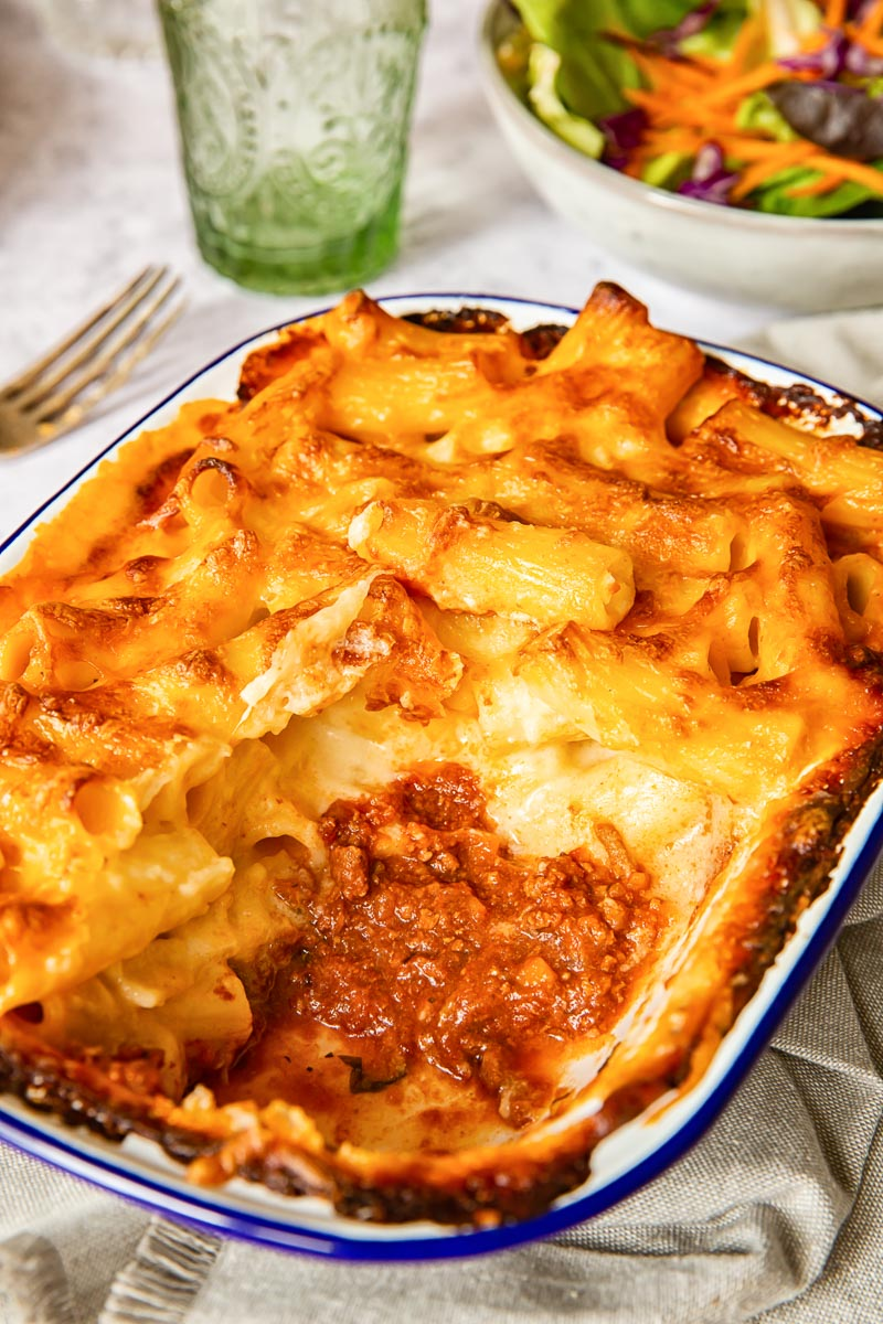 Baked Mac and Cheese with a bottom layer of bolognese sauce