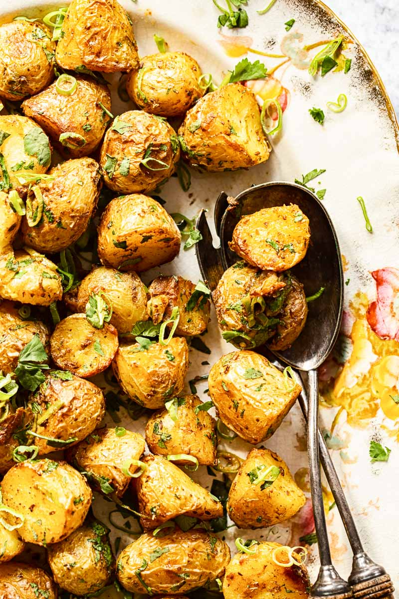 Roasted Baby Potatoes sprinkled with sliced green onions and cilantro
