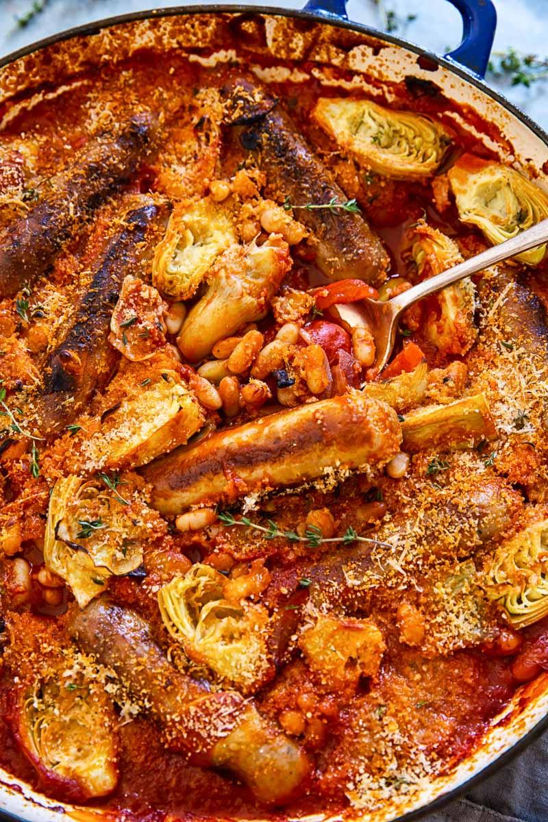 Sausage, white bean and artichoke casserole in tomato sauce
