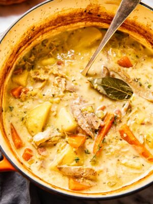 creamy turkey stew with carrots and potatoes in a soup pot
