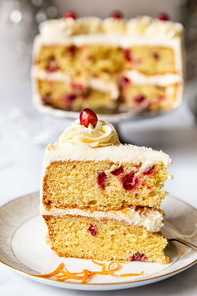 a slice of cranberry cake with cream cheese frosting