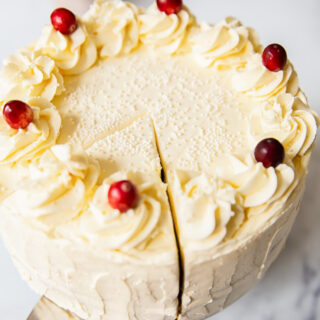 Cranberry Cake with Cream Cheese Icing and topped with fresh cranberries