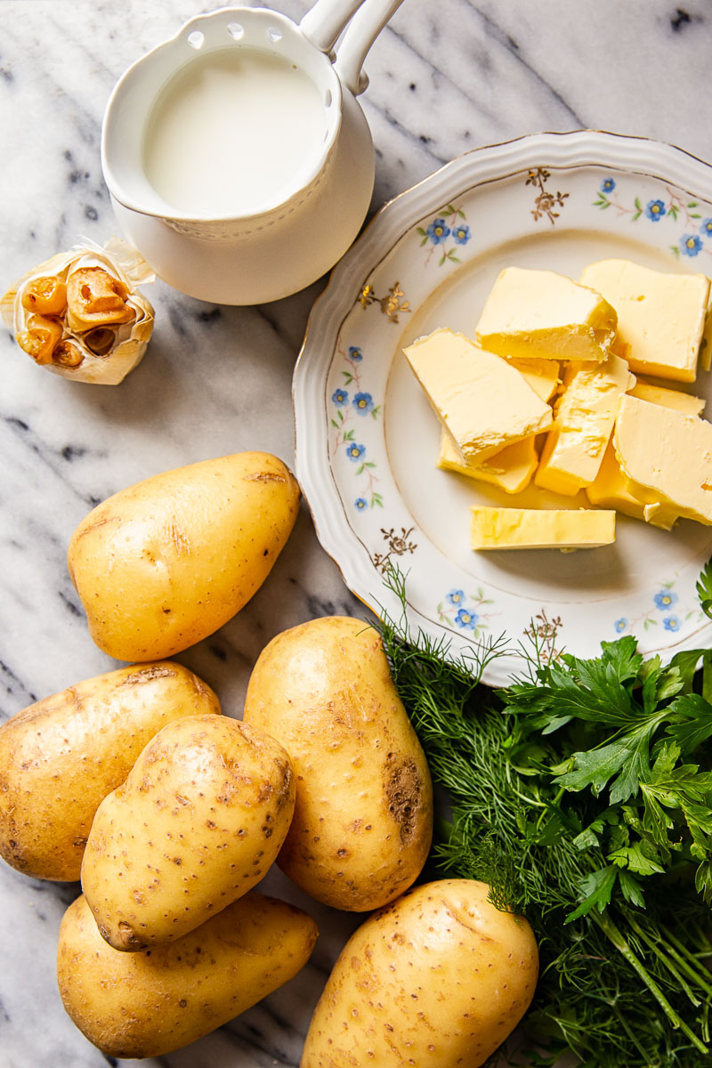 Mashed potato ingredients. Potatoes, butter, milk plus herbs and garlic for extra flavour.