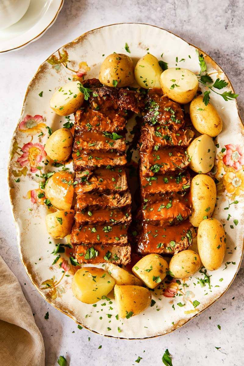 beef brisket and potatoes on platter