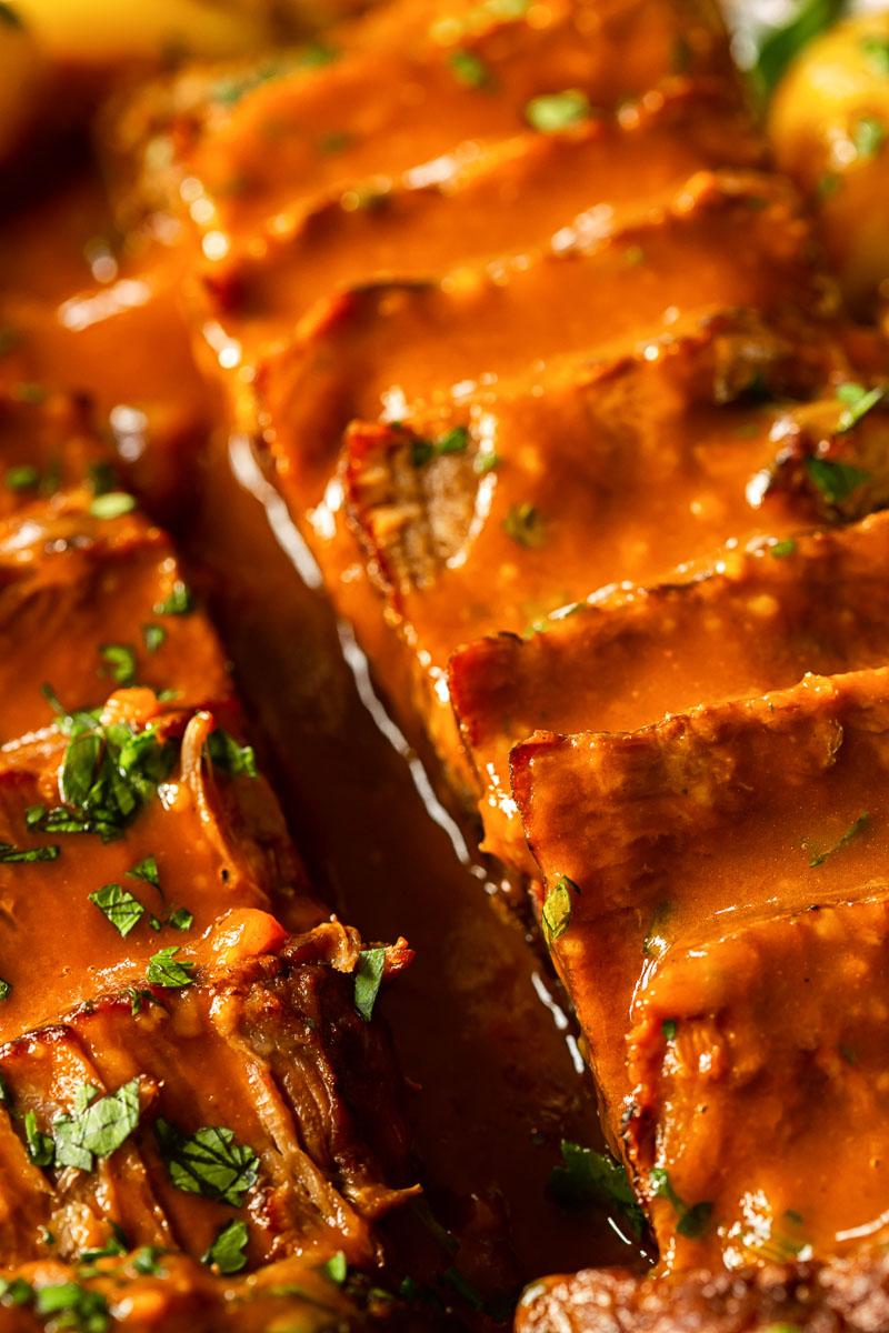 beef brisket covered in gravy closeup