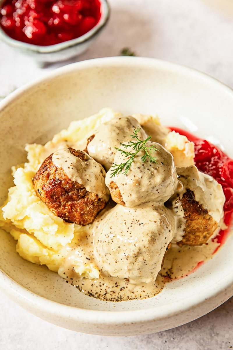 meatballs in sauce over mashed potatoes