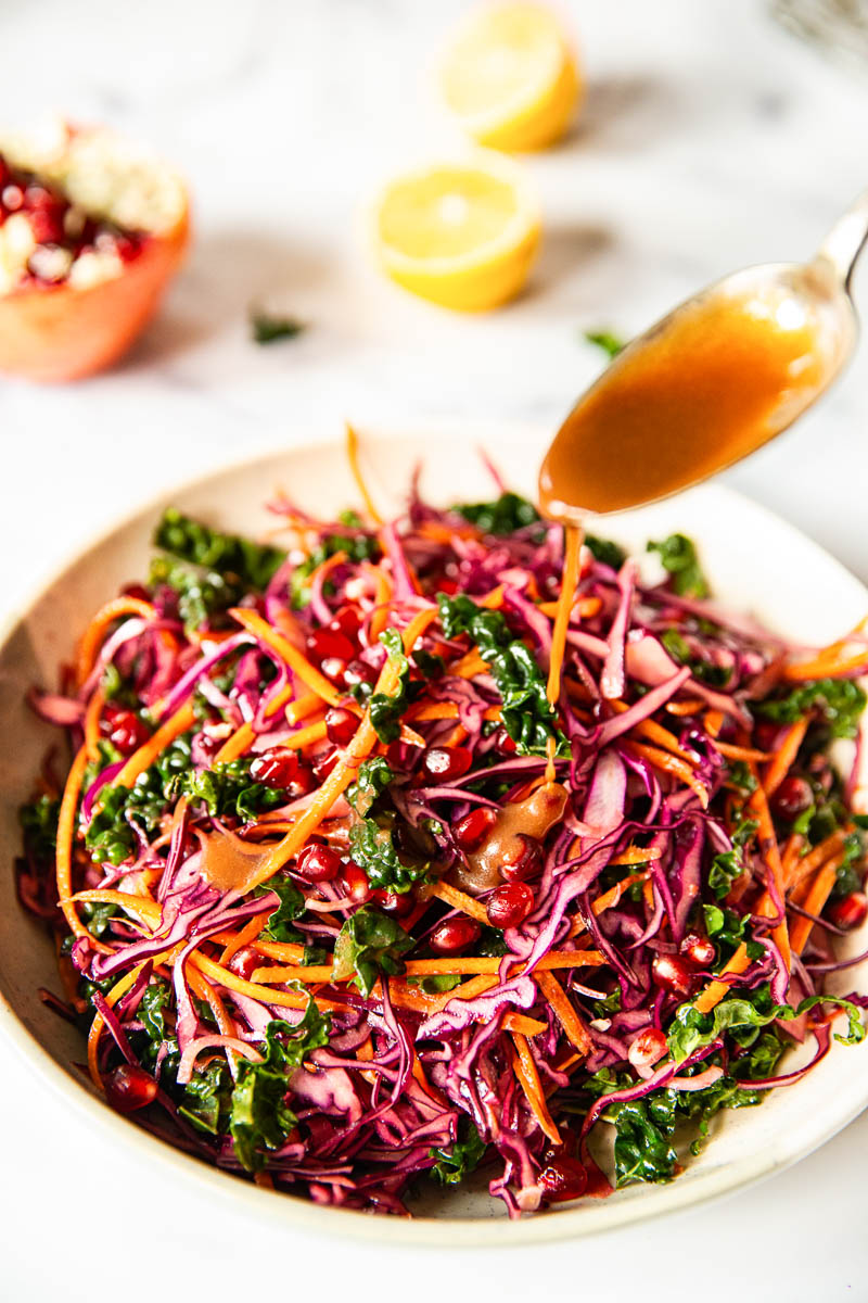 Red Cabbage Slaw with Carrots and Pomegranate in a bowl