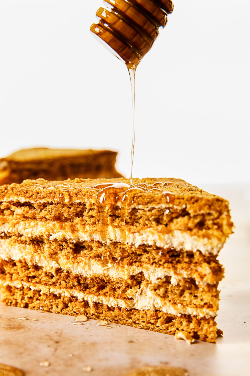 a slice of honey cake with honey drizzled over it