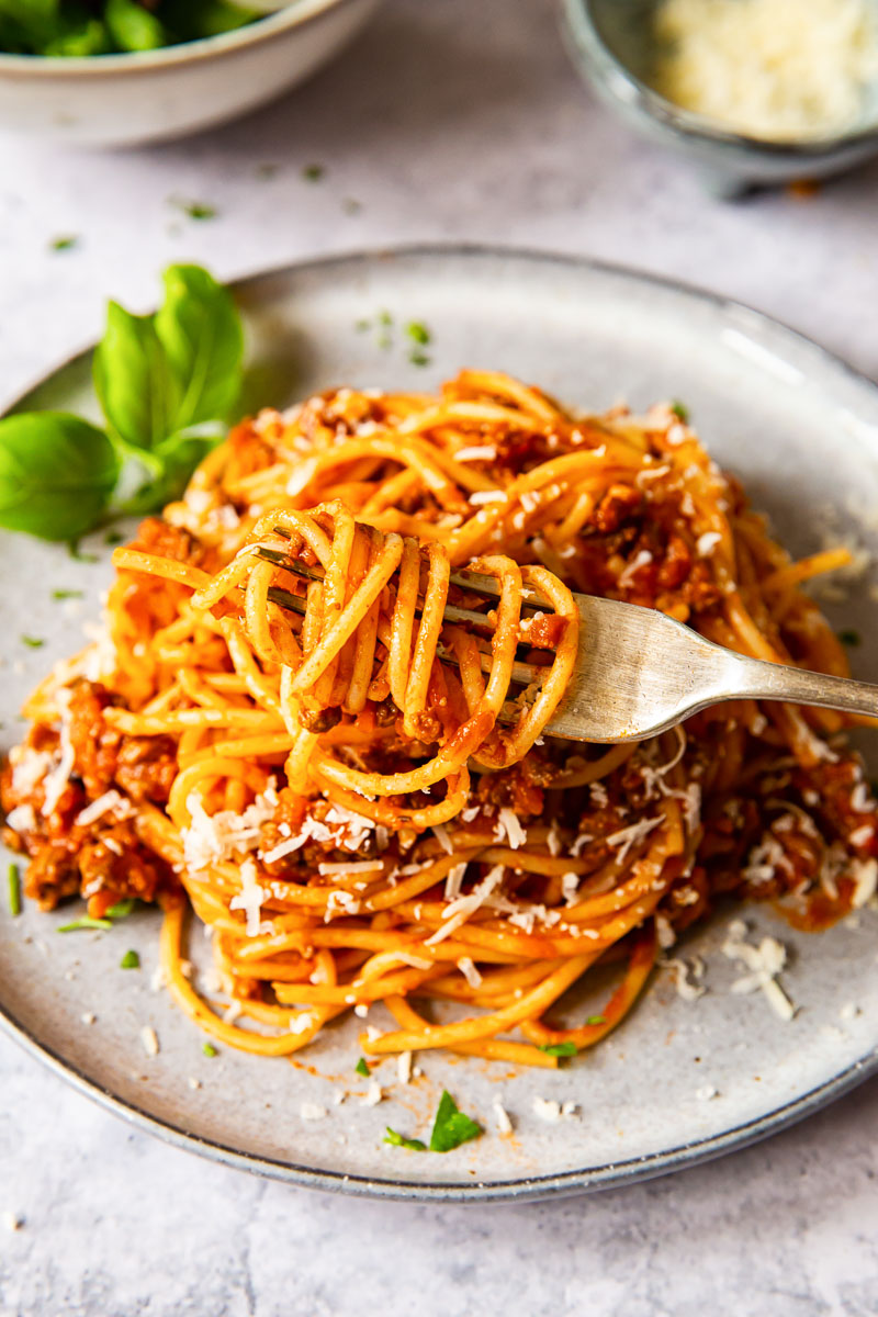 traditional spaghetti bolognese on grey plate