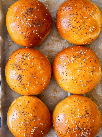 bread rolls sprinkled with poppy seeds and sesame seeds