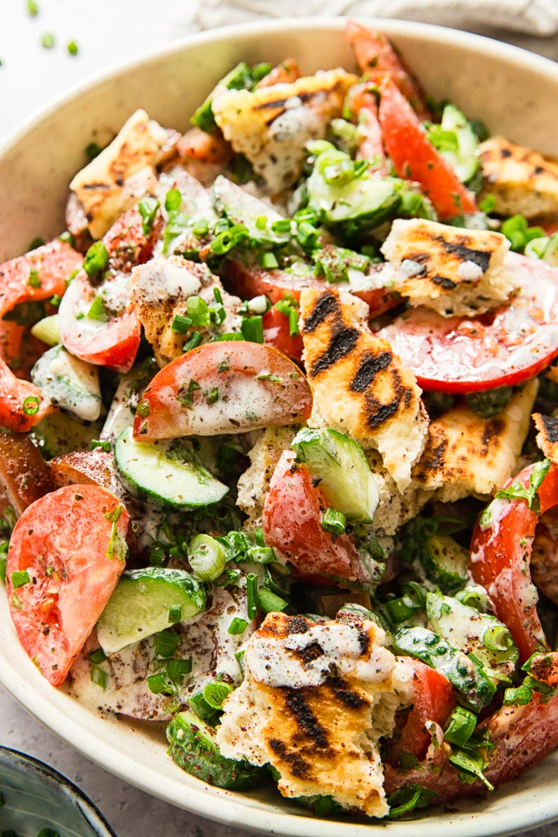 Lebanese salad with tomatoes and cucumber in tangy buttermilk dressing