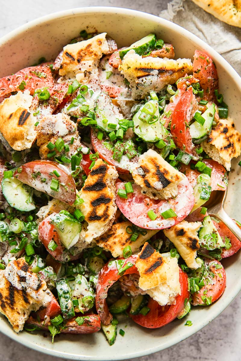 tomato and cucumber salad with grilled pita
