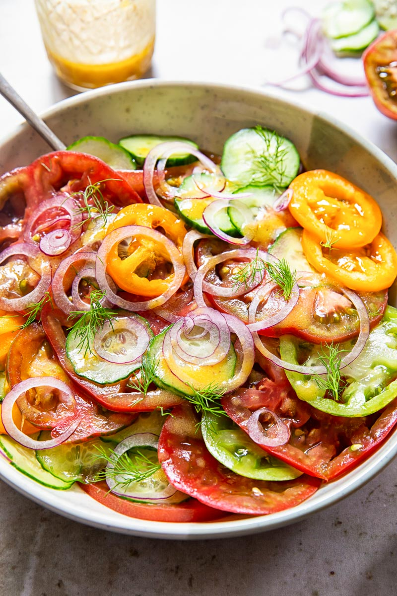 heirloom tomato and cucumber salad in a bowl