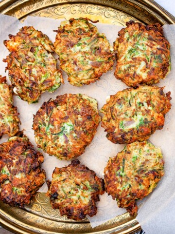 zucchini fritters on bronze platter