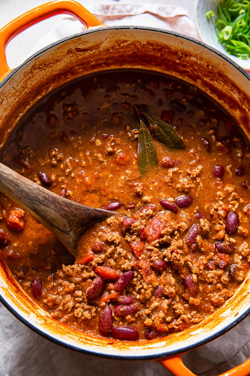 chili with beans in orange Dutch Oven pot