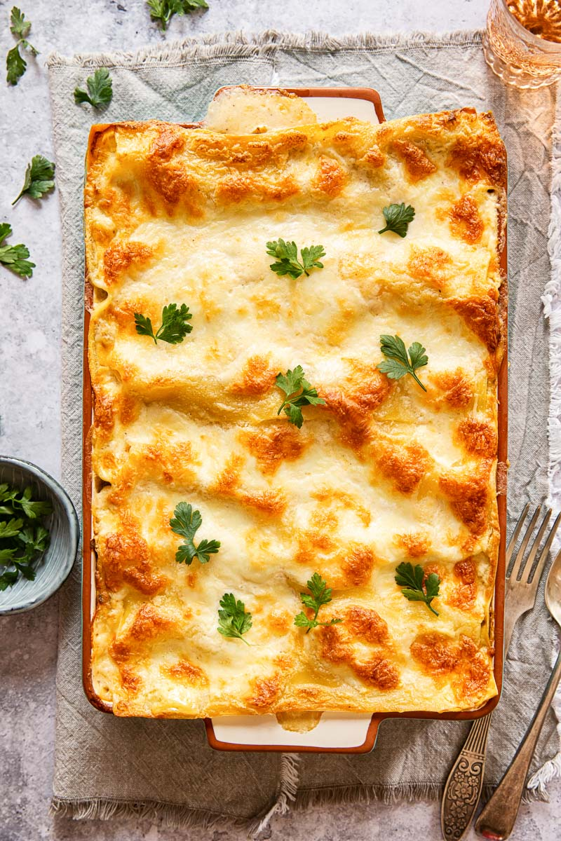 top down view of seafood lasagna topped with parsley leaves
