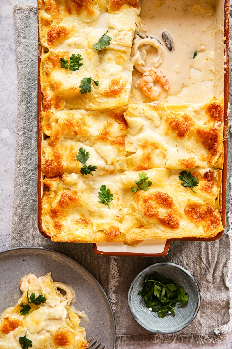 top down view of white lasagna with seafood showing
