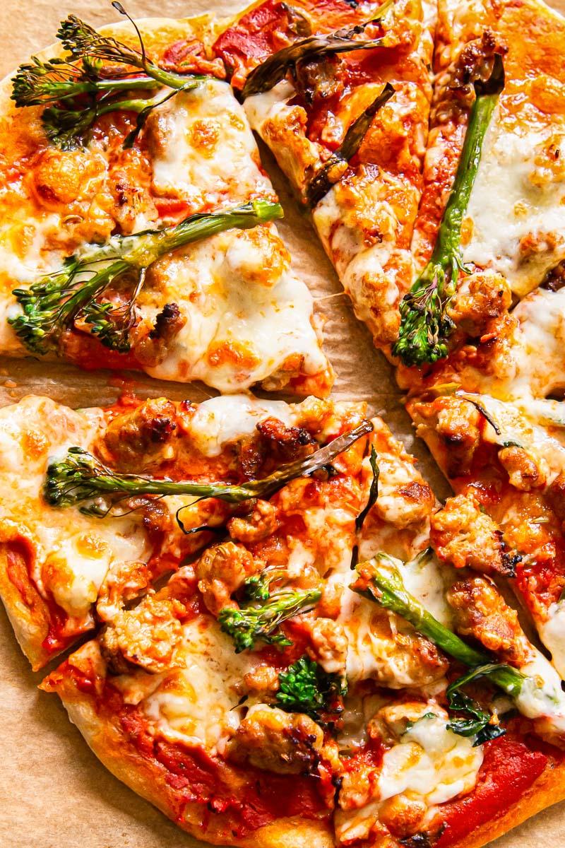 sausage and broccoli pizza sliced