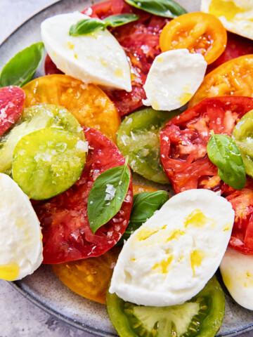 caprese salad on grey plate