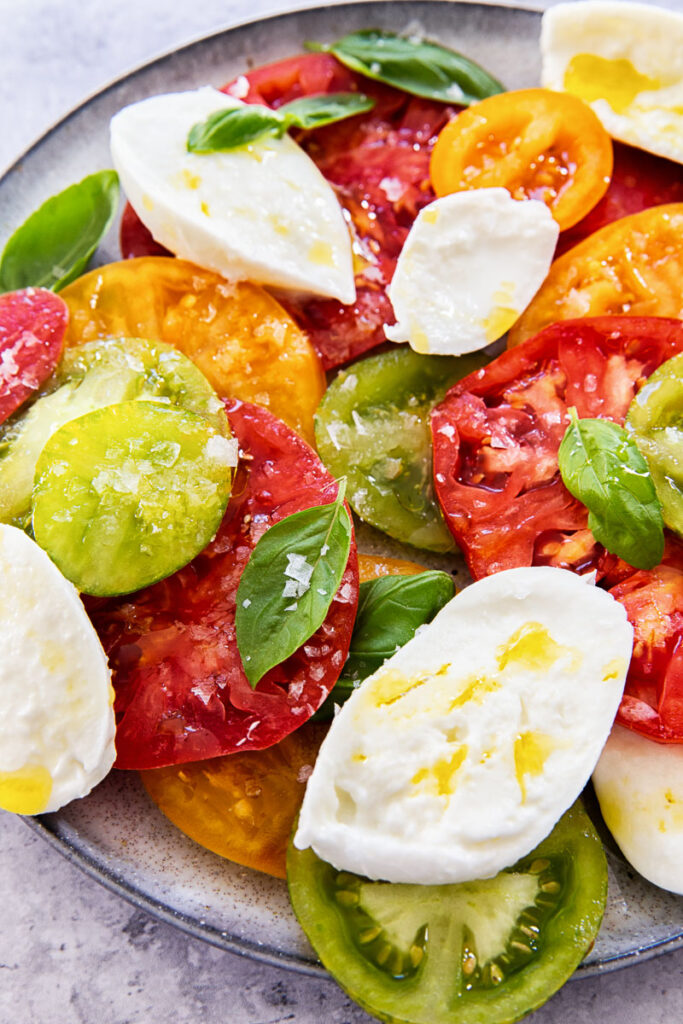 caprese salad on grey plate