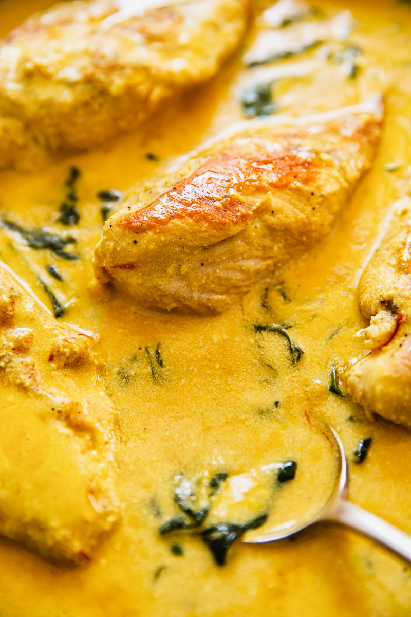 saffron cream sauce close up with chicken breasts