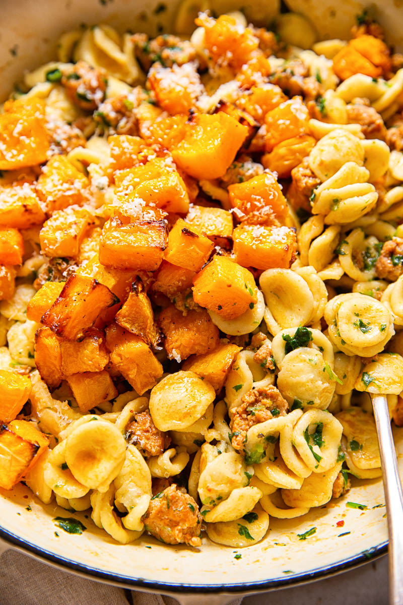 roasted butternut squash on top of orecchiette pasta