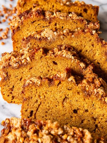 sliced pumpkin bread on marble countertop