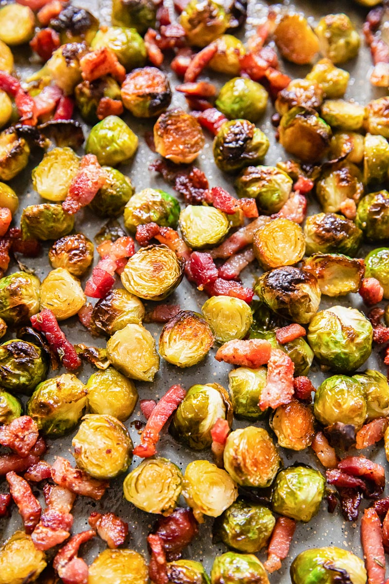 crispy brussels sprouts with bacon on roasting pan