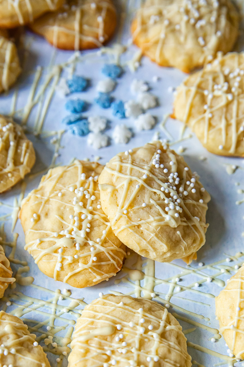 cookies drizzled with white chocolate on light blue background