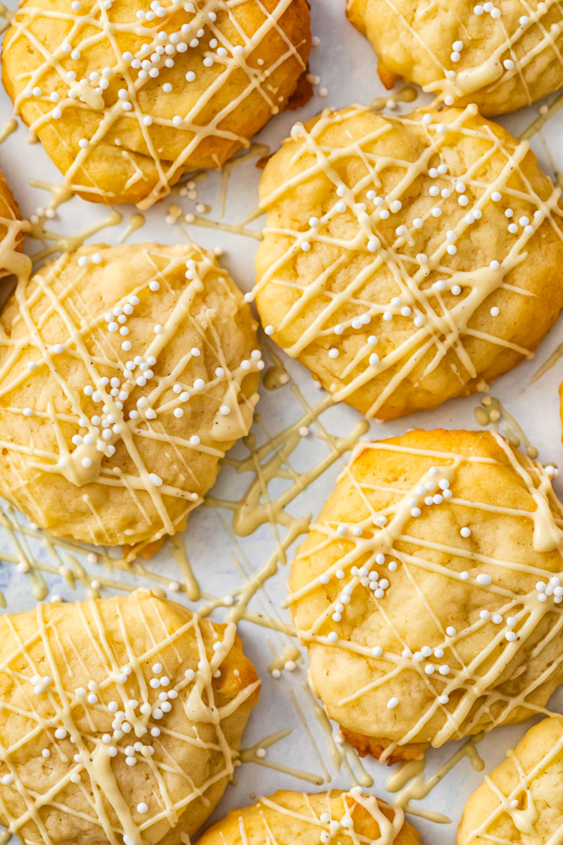 cookies with white chocolate drizzle and white sprinkles