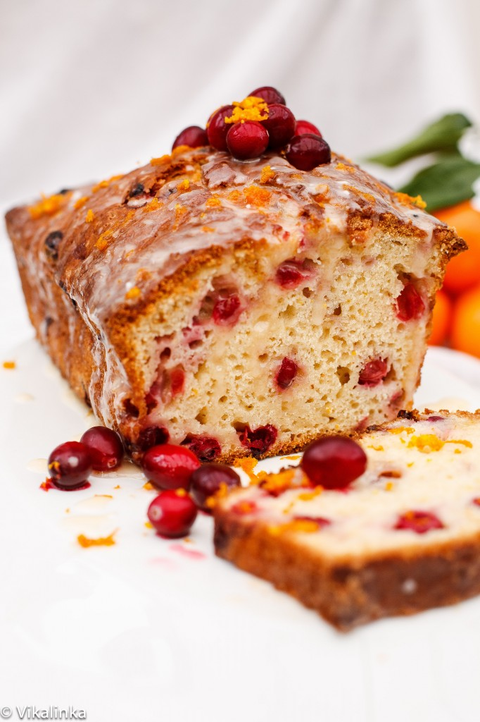 cranberry bread with orange glaze, one slice cut off the loaf