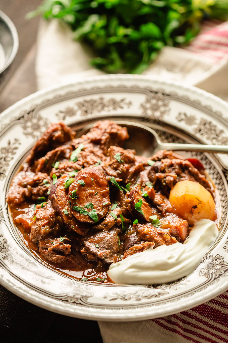 beef stew in a bow with a dollop of sour cream