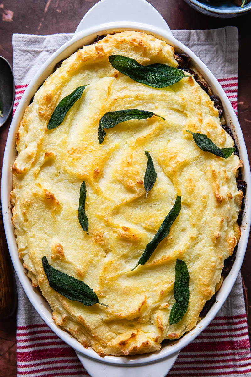 mashed potato casserole topped with fried sage leaves