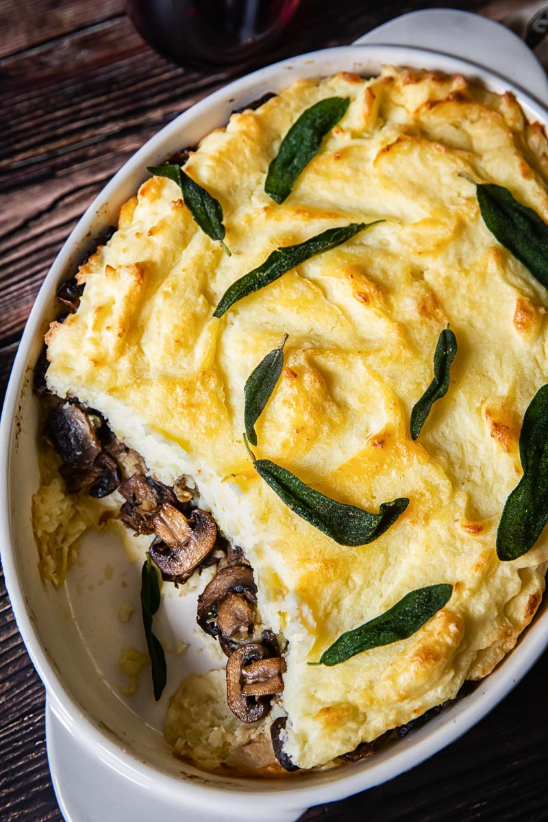 Mashed Potato Casserole with Mushrooms showing in the middle layer