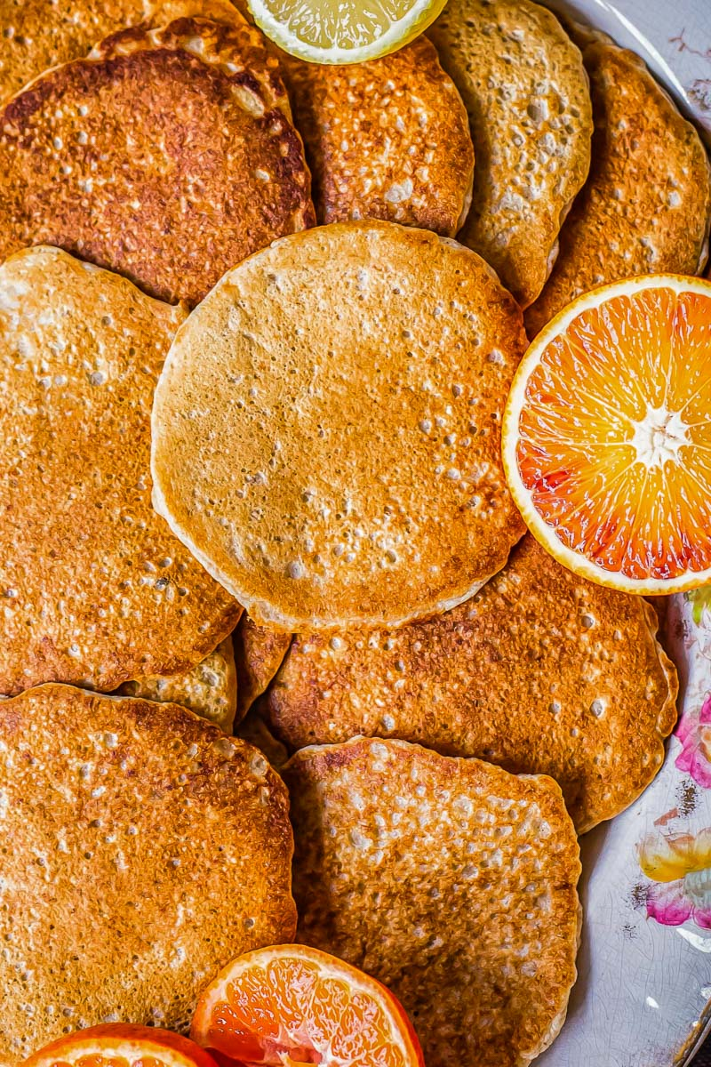pancakes and sliced blood oranges on a platter