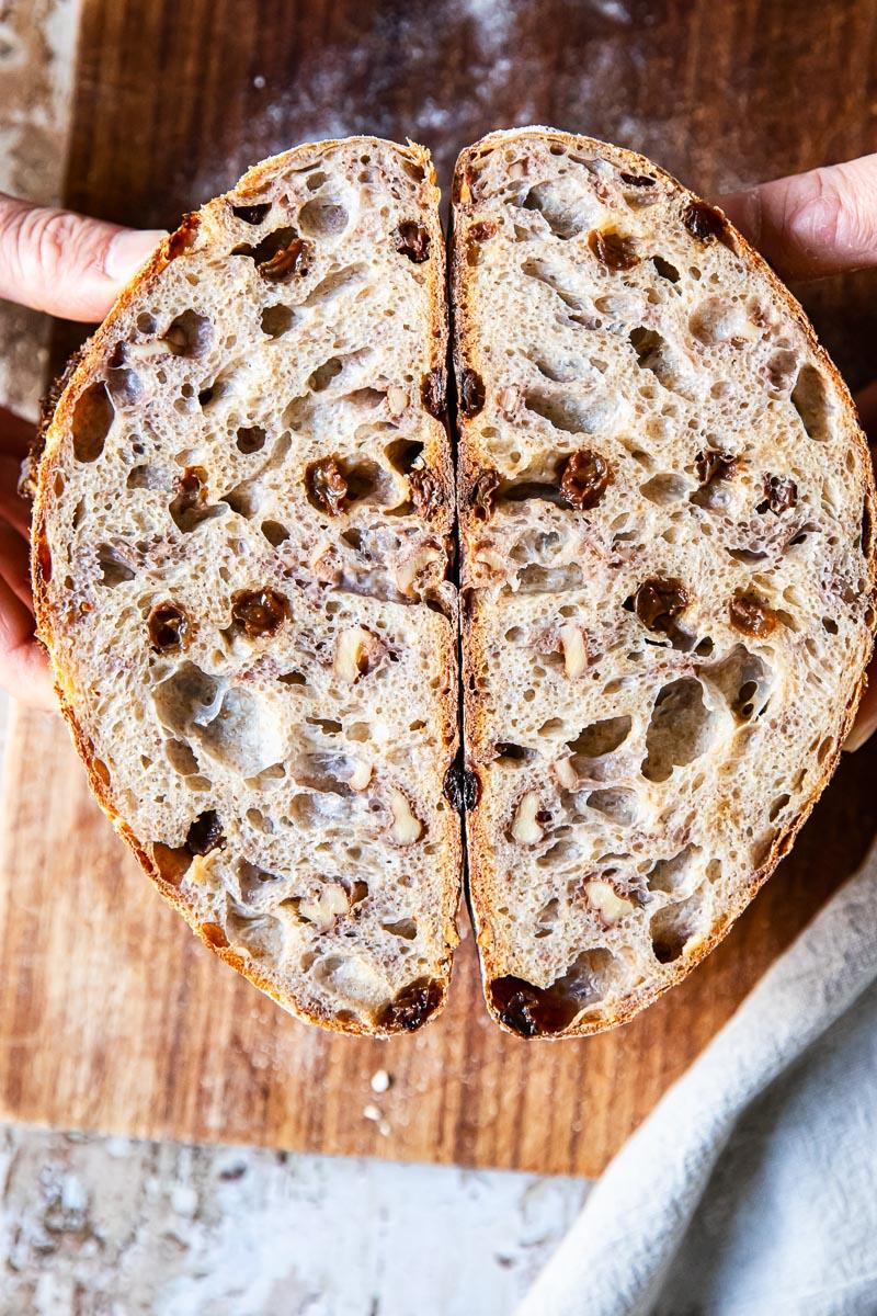 walnut and raisin bread cut in halh