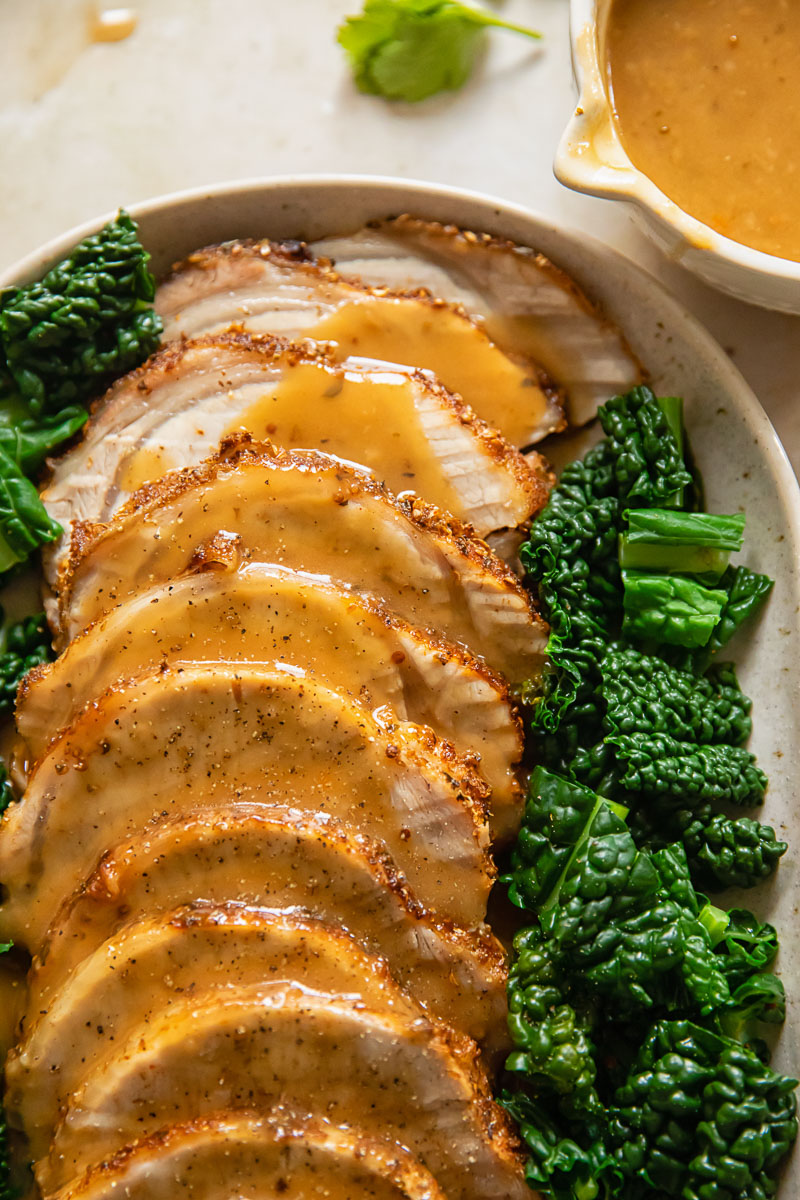 sliced pork loin roast covered with gravy
