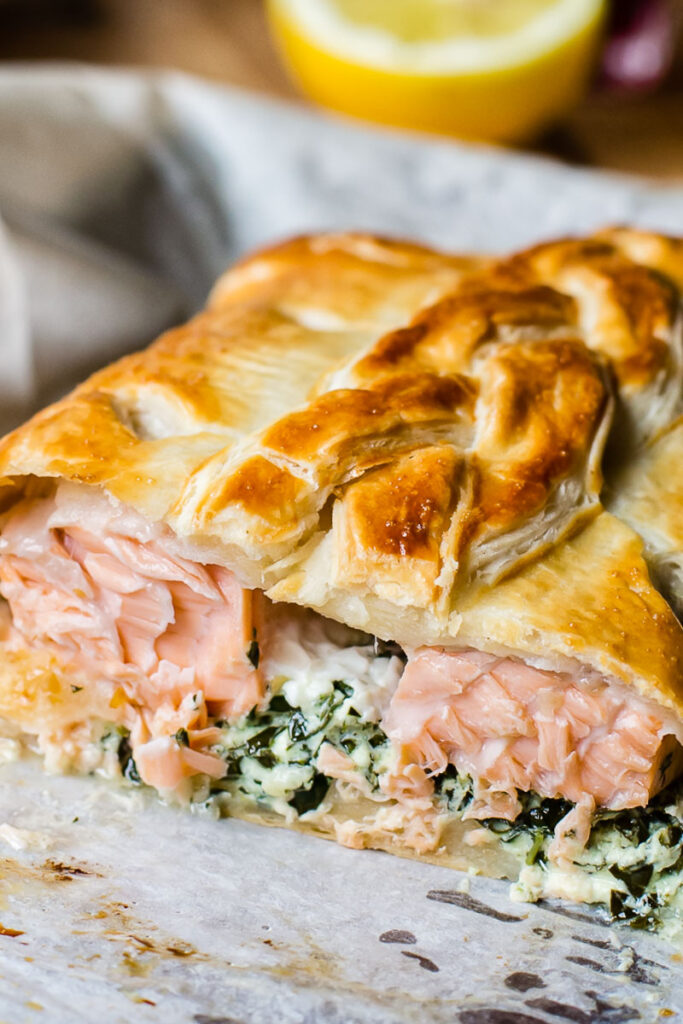 salmon en croute close up with salmon exposed