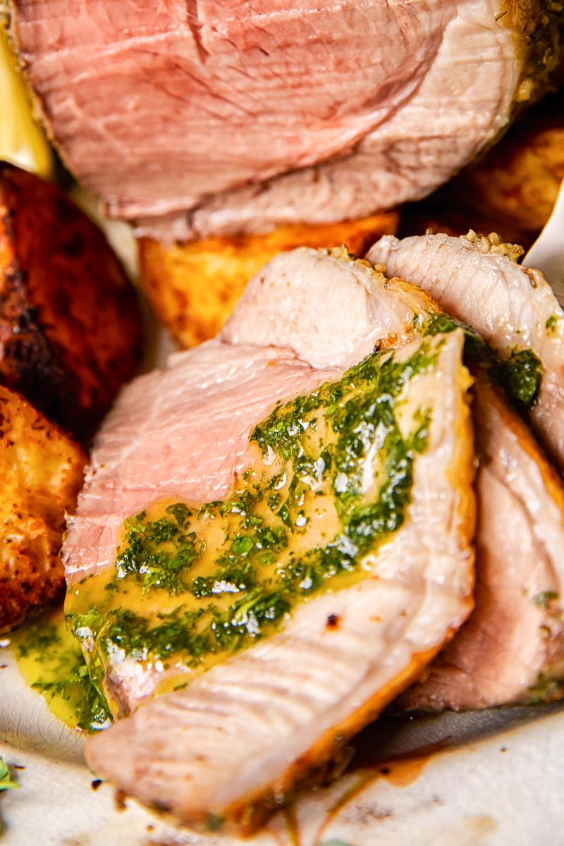 mint sauce spread over a slice of roast lamb