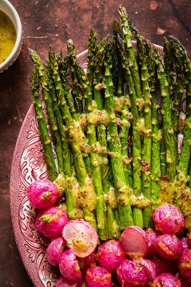roasted radishes and asparagus on a platter