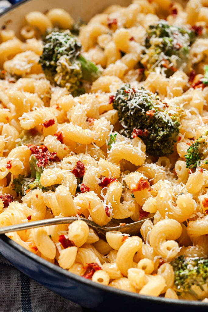 pasta with broccoli and sun-dried tomatoes in a pan