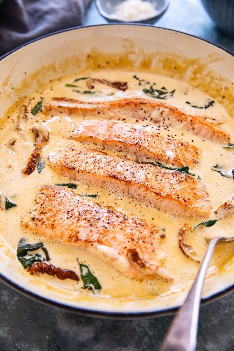salmon in cream sauce in a while pan