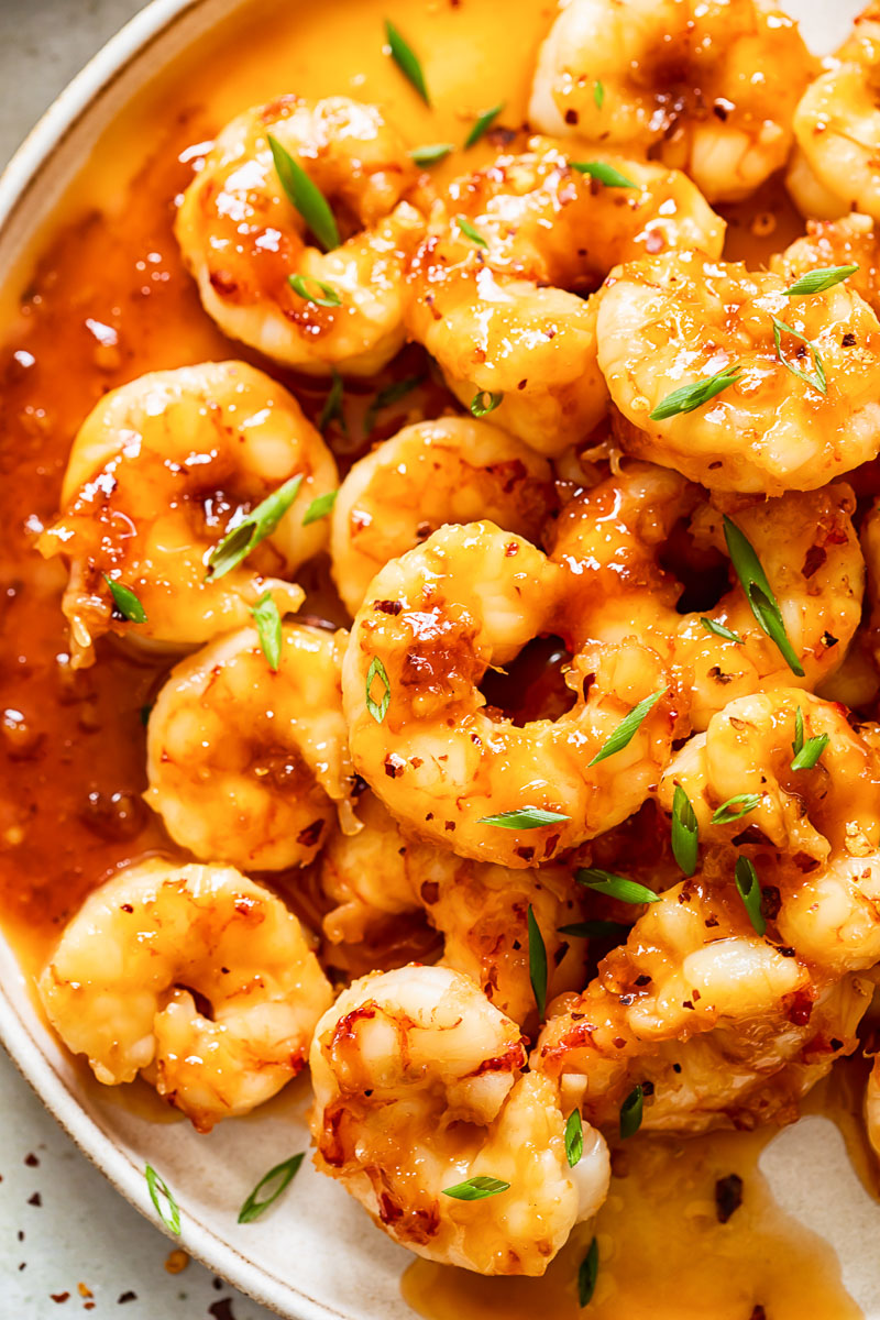 top down view of honey garlic shrimp on a plate.