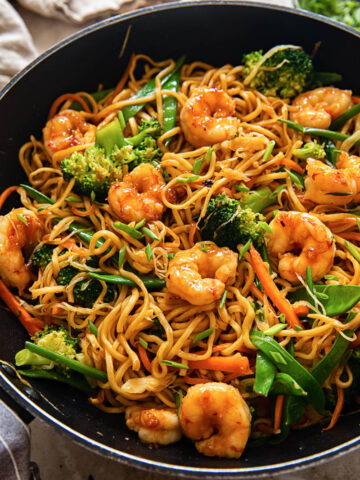 top down view of shrimp with stir fried noodles and vegetables