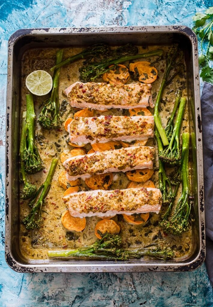 top down view of salmon pieces with broccoli in a roasting pan